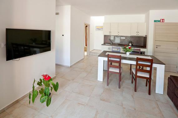 Obývací pokoj s kuchyní (stejné v apartmánech 3,4 a 5)